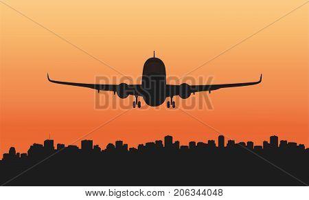 A passenger plane and a big city.