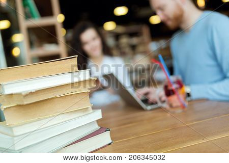 Portrait of young students studying in bookstore together