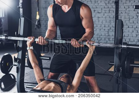 Trainer Helping Woman Weightlifting