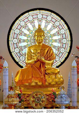Golden buddha statue with Dharma wheel at Wat Phasornkaew A famous buddhist temple Phetchabun Thailand