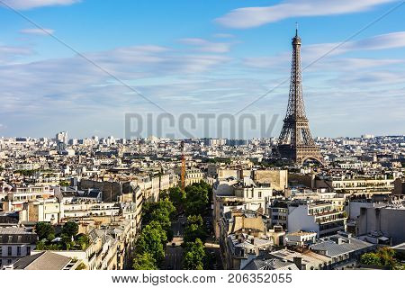 Paris cityscape with Eiffel Tower from the top of Triumphal Arch of the Star (Arc de Triomphe de l'Etoile) at the summer sunset. Paris France