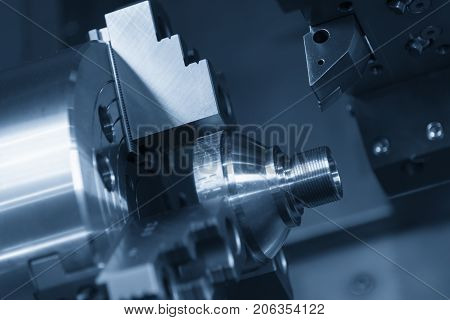 CNC lathe machine or Turning machine chucking the steel cone shape rod .Hi technology manufacturing process.