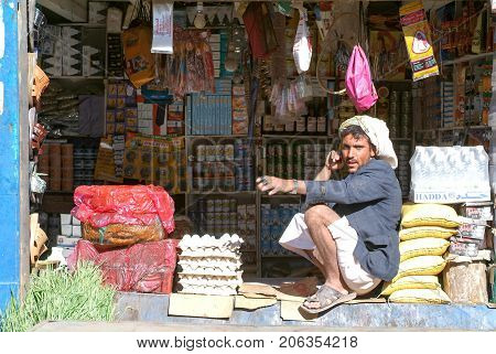 Man Selling Food On His Small Shop At Habbabah