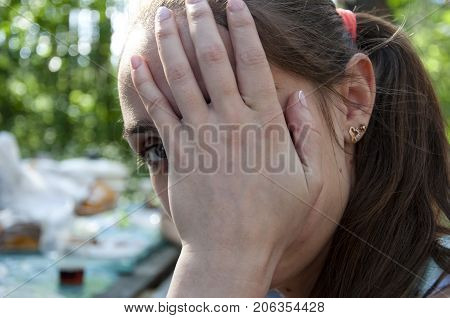 Girl Hiding Eyes On Cute Face With Hand