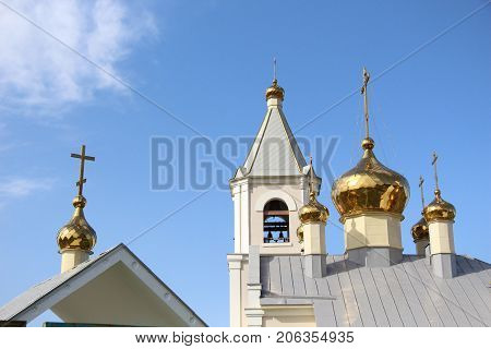 Orthodox monastery / View of the bell tower / Landscape with a bell tower and a monastery