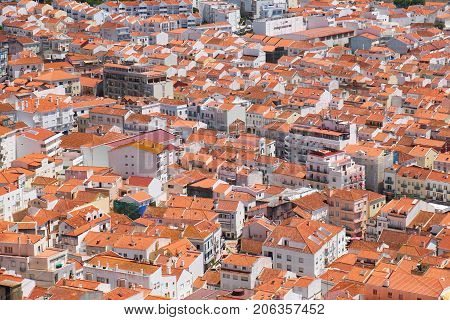 Bird's-eye View On Buildings Red Tiled Roofs Of Nazare Town. Portugal
