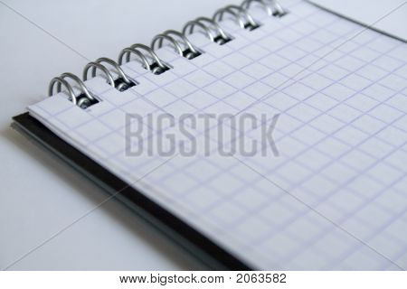 A Notebook On The White Background