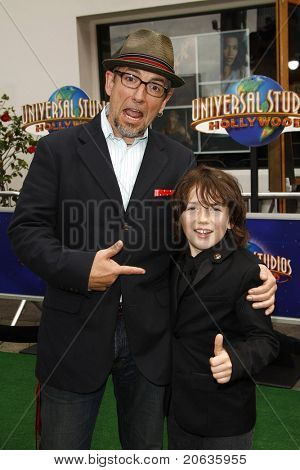 LOS ANGELES - MAR 27:  Django Marsh and his father arrive at the World Premiere of 'HOP' held at Universal Studios Hollywood on March 27, 2011 in Los Angeles, California
