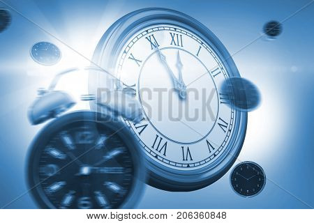 Digital image of alarm and wall clocks against white background