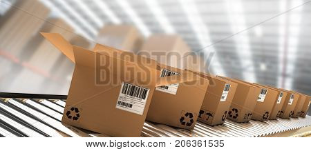 Row of brown boxes on conveyor belt against boxes in illuminated warehouse