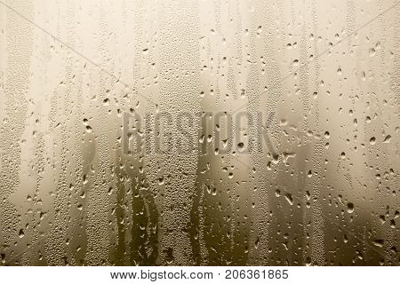 misted glass on the window as a background .