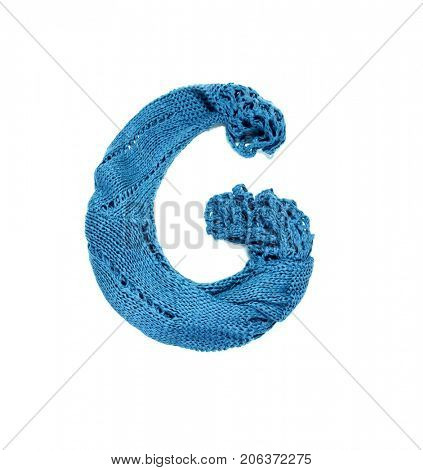 Knitting alphabet. Letter of knit handmade alphabet on white background. Letter G of knit handmade alphabet