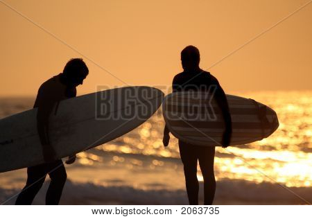 Silhouette Of Surfers