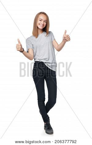 Teen girl in full length giving double thumb up sign, isolated on white background