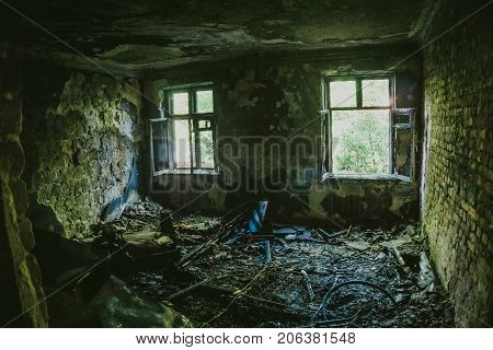 Interior of burnt by fire apartment in an apartment building, burned furniture, can be used as war concept