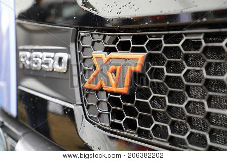 HYVINKAA FINLAND - SEPTEMBER 8, 2017: Detail of Scania XT truck grille in rain. Scania Suomi Oy presents the new XT heavy duty truck range on Maxpo 2017.