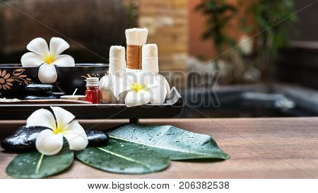 Thai Spa massage compress balls herbal ball on the brown wooden with treatments spa for wellness and healthy background nature Thailand. Healthy Concept.