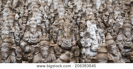 Many hand crafted Ganesha idol clay statues displayed in the market during Ganesh Festival.