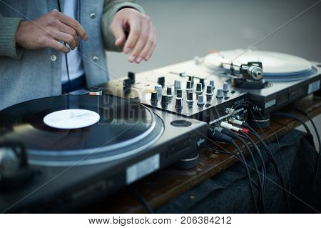 turntable scratch, hand of dj on the vinyl record