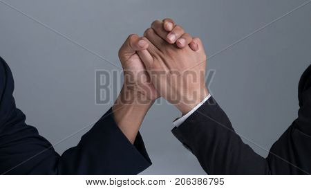 Businessman Engaged In Arm Wrestling
