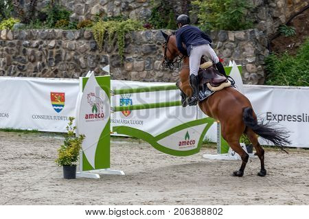 HERNEACOVA ROMANIA - SEPTEMBER 24 2017: Rider and horse at show jumping on equestrian event Herneacova International Jumping