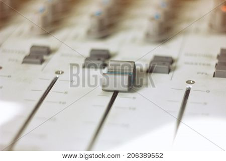 Audio Mixing BoardProfessional audio mixing console with faders and adjusting knobsTV equipment Black and White selective focus