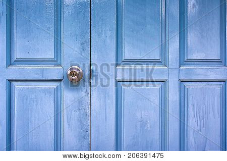 Blue Painted Wooden Doors with a Door Knob