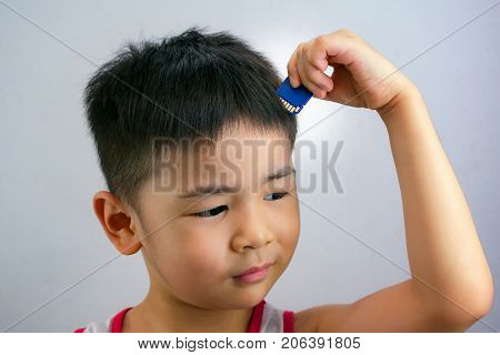 Child Trying to Insert a Memory Card into His Head