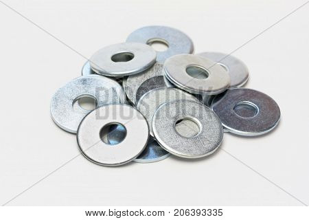 steel washers on a gray background closeup