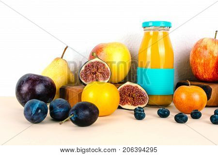 Multivitamin juice with organic autumn seasonal fruits. Diet and healthy food concept.