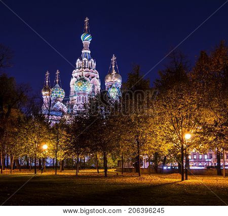 Night autumn view of illuminated Church of the Savior on Spilled Blood and Mikhailovskiy Garden Saint Petersburg Russia