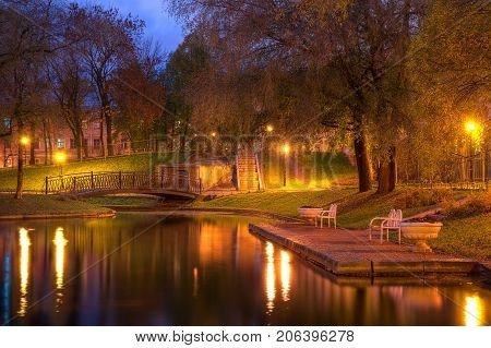 Twilight autumn view of park and pond in Yusupov Garden Saint Petersburg Russia
