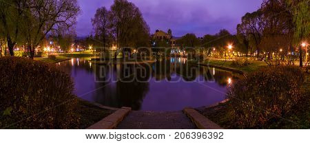 Dusk panoramic autumn view of park and pond in Yusupov Garden Saint Petersburg Russia