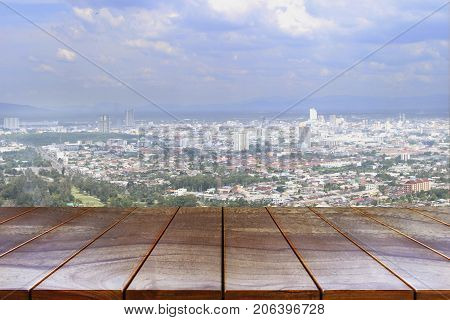 Empty wooden table space platform and City view and sky background for product display montage Wood table for product placement.