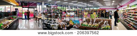 BANGKOK THAILAND - AUGUST 01: MaxValu supermarket serves multiple unidentified customers on a weekday on August 01 2017 in Bangkok.