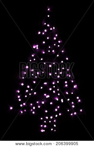 Purple Bright Glowing Magic Christmas Tree. Silent And Peaceful Atomosphere. Christmas Card For Happy Holidays Or Seasons Greetings