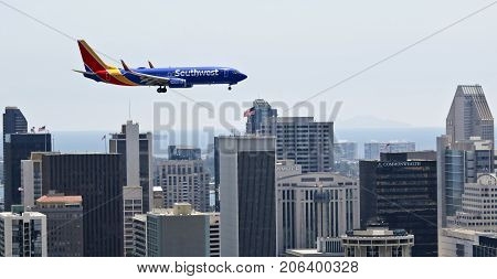 SAN DIEGO, CALIFORNIA, JUNE 7. Downtown on June 7, 2017, in San Diego California. A Southwest Boeing 737 Flaps and Landing Gear Down on Approach in San Diego in California.