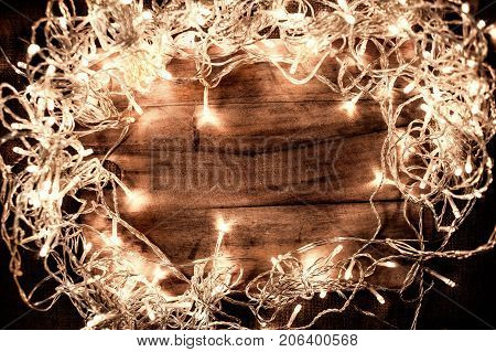 Abstract Glowing Christmas Lights in wreath shape greeting card for xmas holidays. Sparkling lights Garlands design