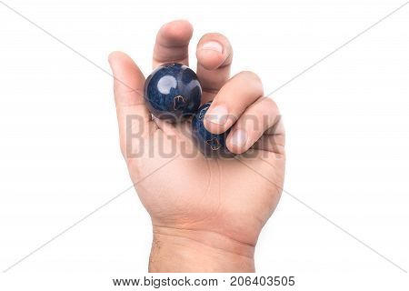 Chinese balls Yin Yan for health in hand isolated on white background poster