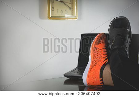 Life balance concept for work and exercise half of business and sport shoes.