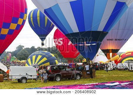 Bristol, UK: August 14, 2016: Inflating the balloons for a mass ascent at the Bristol International Balloon Fiesta. The annual event has become Europe's largest hot air balloon festival.