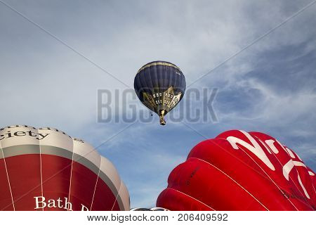 Bristol, UK: August 13, 2016: Inflating the balloons at the Bristol International Balloon Fiesta. The annual event has become Europe's largest hot air balloon festival.