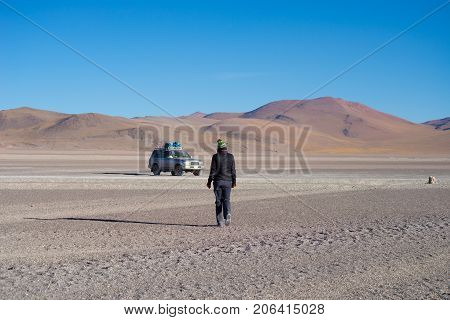 4X4 Vehicle Taking Tourists On The Desertic Highlands Of The Andes In Huayllajc, Bolivia, Roadtrip T