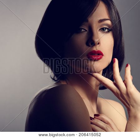 Mystic Beautiful Makeup Expression Woman With Short Hair Style, Red Lipstick And Manicured Nails On