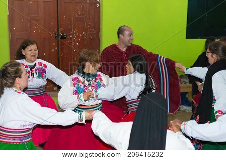 Amantani, Peru - August 31, 2015: Tourist, Musicians And Local People Performing Traditional Dance I