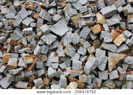 Gray gravel photo for background. Sharp stones in pile for construction. Road or building construction supply. Gray rocks bunch for wallpaper or banner template. Natural texture picture.