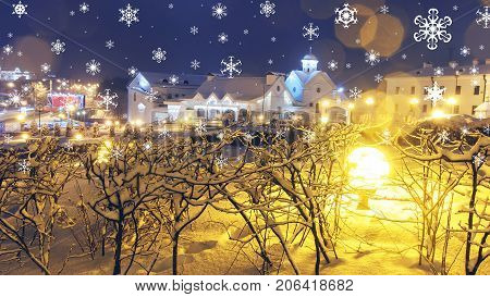 Xmas background. New Year's fairy tale in night city. Falling snowflakes and shining lanterns of Christmas city. Theme of Christmas and New Year.
