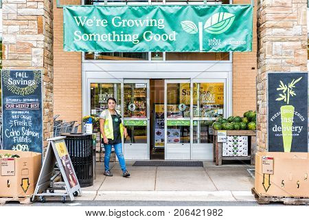 Fairfax, Usa - September 8, 2017: People And Female Worker, Representative Entering Whole Foods Mark