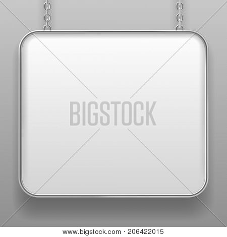 White sign with metallic frame and with rounded corners hanging from a chain against a light gray background. Signboard in shades of gray