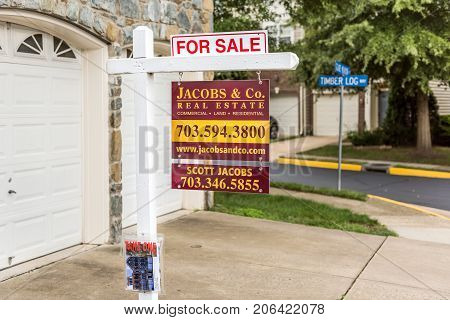 Fairfax, Usa - September 8, 2017: For Sale Real Estate Sign In City In Virginia With Garage At Corne